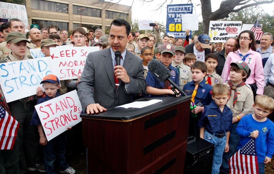 "Surrounded by area scouts, Jonathan Saenz, president of Texas Values, reads the press release to that crowd announcing that the Boy Scouts of America will be postponing its decision to admit gays at the ""Save Our Scouts"" Prayer Vigil and Rally in front of the Boy Scouts of America National Headquarters in Irving, Texas, Wednesday, February 6, 2013. (AP / Richard Rodriguez)"