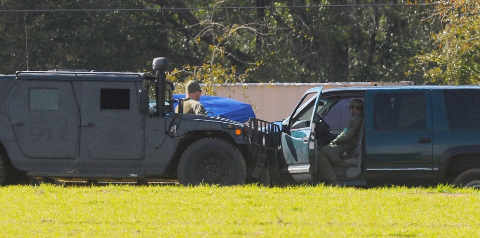 The FBI and other authorities continue to process the crime scene at the bunker where Jimmy Lee Dykes was killed after holding a 5-year-old boy captive for nearly a week in Midland City, Ala., Wednesday afternoon Feb. 6, 2013. (AL.com / Joe Songer )