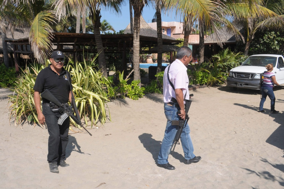 Police patrol on the beach outside a home after masked armed men broke into the home in Acapulco, Mexico, Tuesday Feb. 5, 2013. (AP / Bernandino Hernandez)