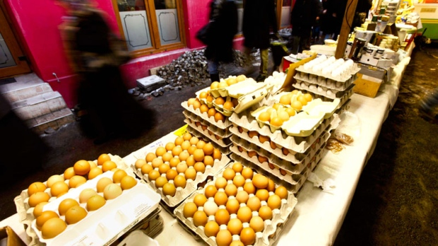 People pass a market stall with eggs at a farmers market in Berlin on Friday, Jan. 7, 2011. (AP / Markus Schreiber)