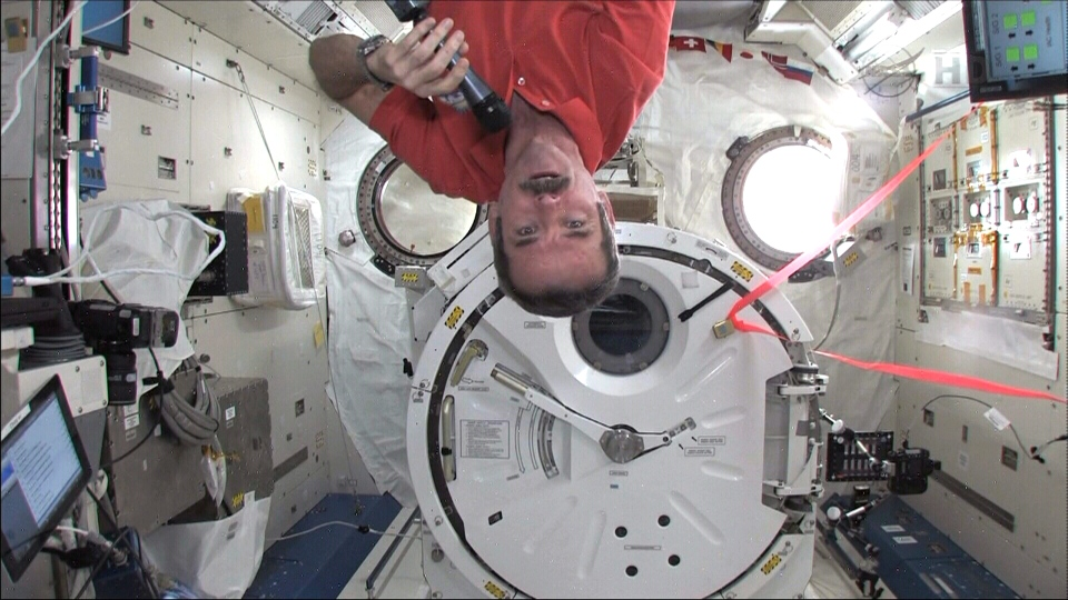 Canadian astronaut Chris Hadfield spins upside down while speaking with William Shatner from the International Space Station in Earth orbit, Thursday, Feb. 7, 2013.