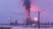 Thick black smoke and flames can be seen in this still image taken from video of the explosion and fire at the Horizon Oilsands facility in Fort McMurray on Thursday January 6, 2011.