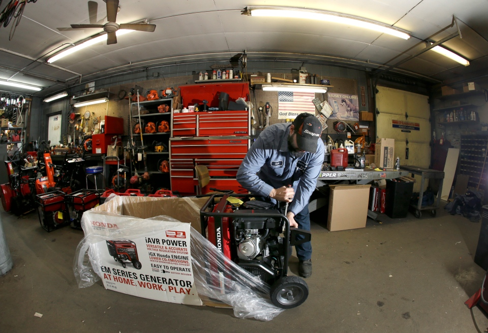 Chris Oppenberg of Andover Small Engine Service assembles a home generator for a customer in preparation for a major winter storm headed toward the U.S. Northeast, in Andover, Mass., Thursday, Feb. 7, 2013. (AP / Elise Amendola)