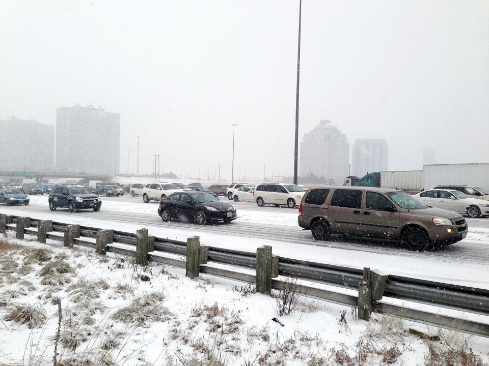 Traffic slows as snow falls on Highway 401 in Toronto on Thursday, Feb. 7, 2013. (Danny Pinto / CTV Toronto)
