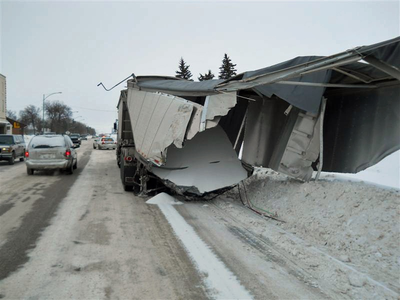 The aftermath of a collision between a semi-trailer and a train in Wadena on Thursday is seen in this photo provided by RCMP.