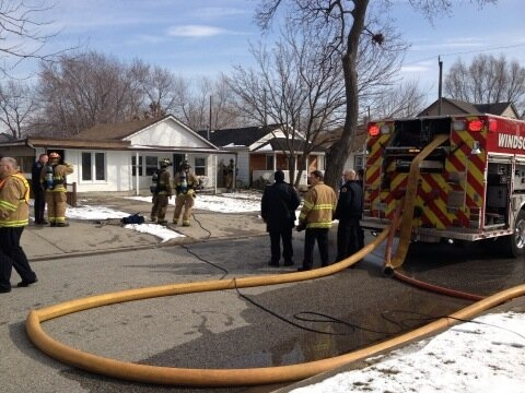 Windsor fire crews at the scene of a house fire at Jos Janisse Avenue in Windsor, Ont., Feb. 7, 2013. (Rich Garton / CTV Windsor)