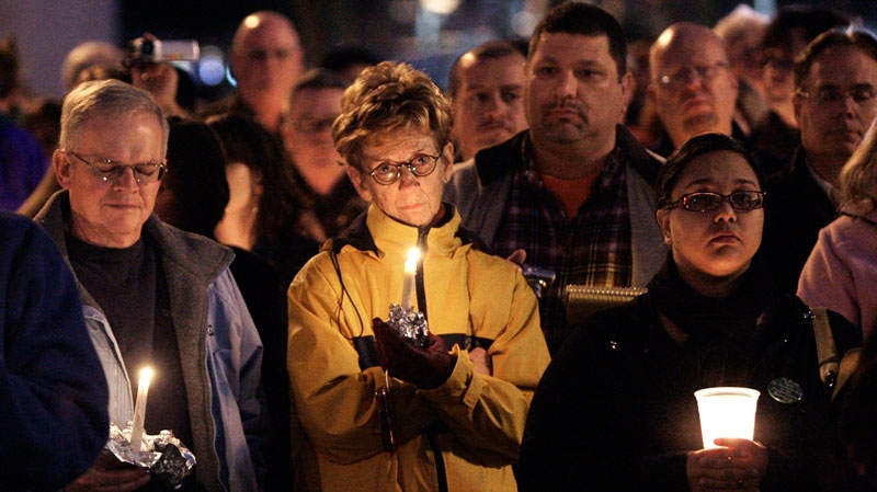 Hundreds gather for a vigil at the Arizona Capitol in Phoenix on Saturday, Jan. 8, 2011. (AP / Ross D. Franklin)