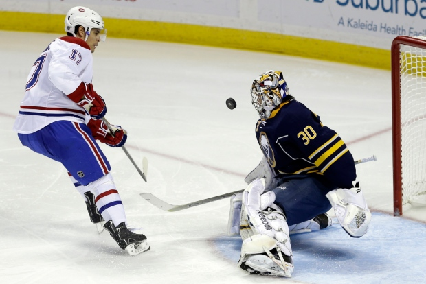 Buffalo Sabres' Ryan Miller (30) stops a shot by M