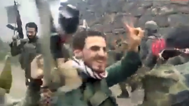 Syrian soldiers dancing as building burns