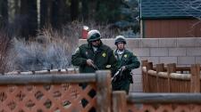 Manhunt for ex-cop suspected killer