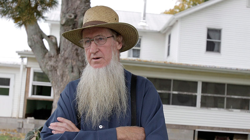 Amish leader Sam Mullet standing in front of his home in Bergholz, Ohio, Oct. 10, 2011. (AP / Amy Sancetta)