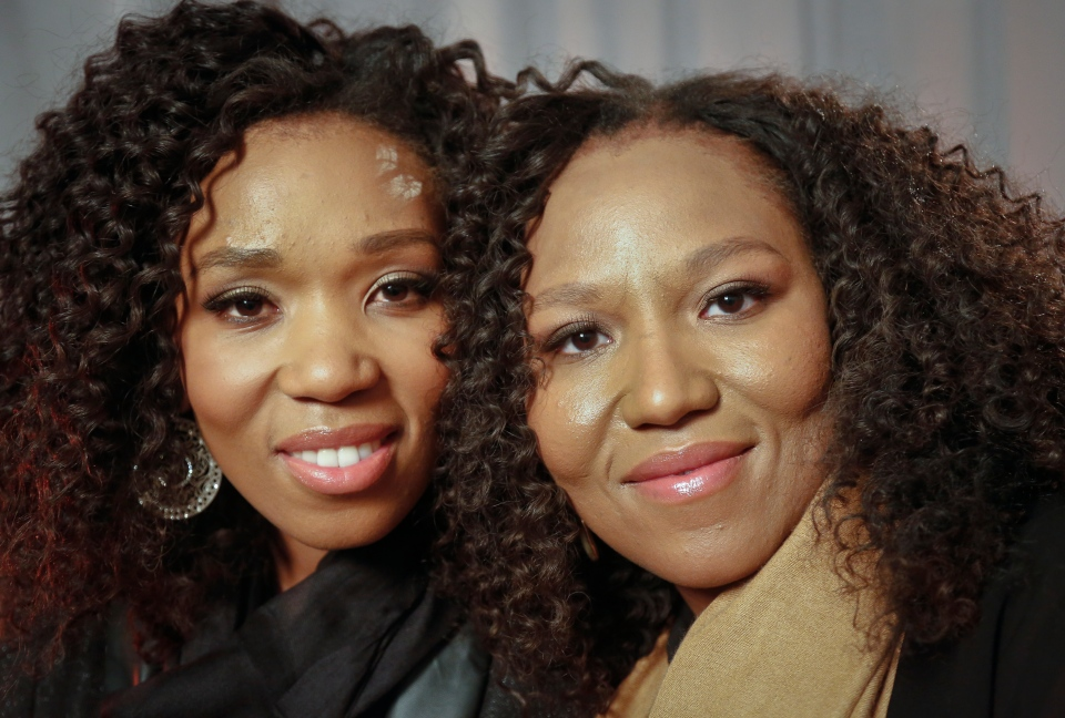 Swati Dlamini, left, and Zaziwe Dlamini-Manaway, granddaughters of Nelson and Winnie Mandela, pose during an interview in New York, Wednesday, Feb. 6, 2013 . (AP / Bebeto Matthews)