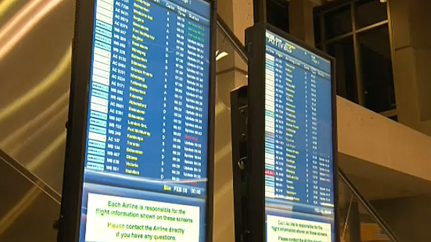 Flight status boards at Calgary International Airport show a number of delays and cancellations to and from destinations in eastern Canada and the northeastern United States.