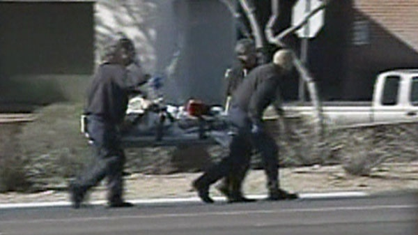 Paramedics rush a shooting victim from the scene of a mass shooting outside a grocery store in Tucson, Ariz. on Saturday, Jan. 8, 2011.