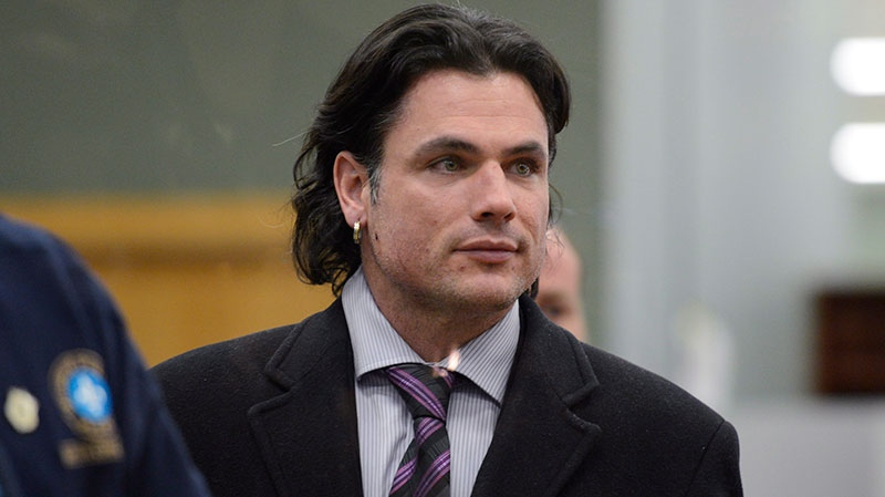 Sen. Patrick Brazeau leaves a courthouse in Gatineau, Que., after he was formally charged with assault and sexual assault Friday, Feb. 8, 2013. (Adrian Wyld / THE CANADIAN PRESS)