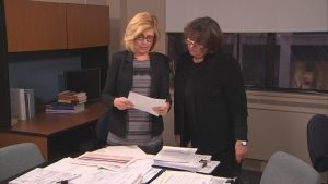 Sandie Rinaldo reviews documents obtained by W5's access to information request with Lynn McDonald, a professor in the Faculty of Social Work with the University of Toronto.