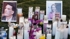 A make-shift memorial stands outside University Medical center in Tucson, Ariz., Sunday, Jan. 9, 2011. (AP / Chris Carlson)
