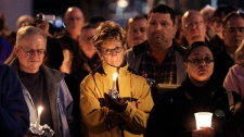 Hundreds gather for a vigil at the Arizona Capitol in Phoenix, Saturday, Jan. 8, 2011. (AP / Ross D. Franklin)