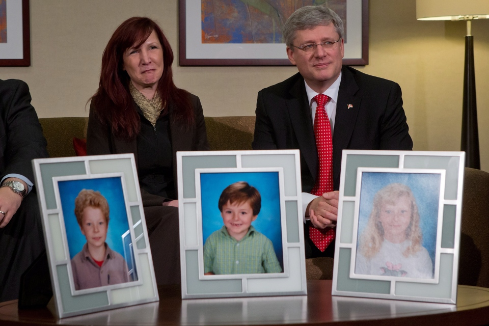 Darcie Clark's cousin Stacy Galt, left, sits with Prime Minister Stephen Harper during a photo opportunity in Burnaby, B.C., on Friday, Feb. 8, 2013. (Darryl Dyck / THE CANADIAN PRESS)