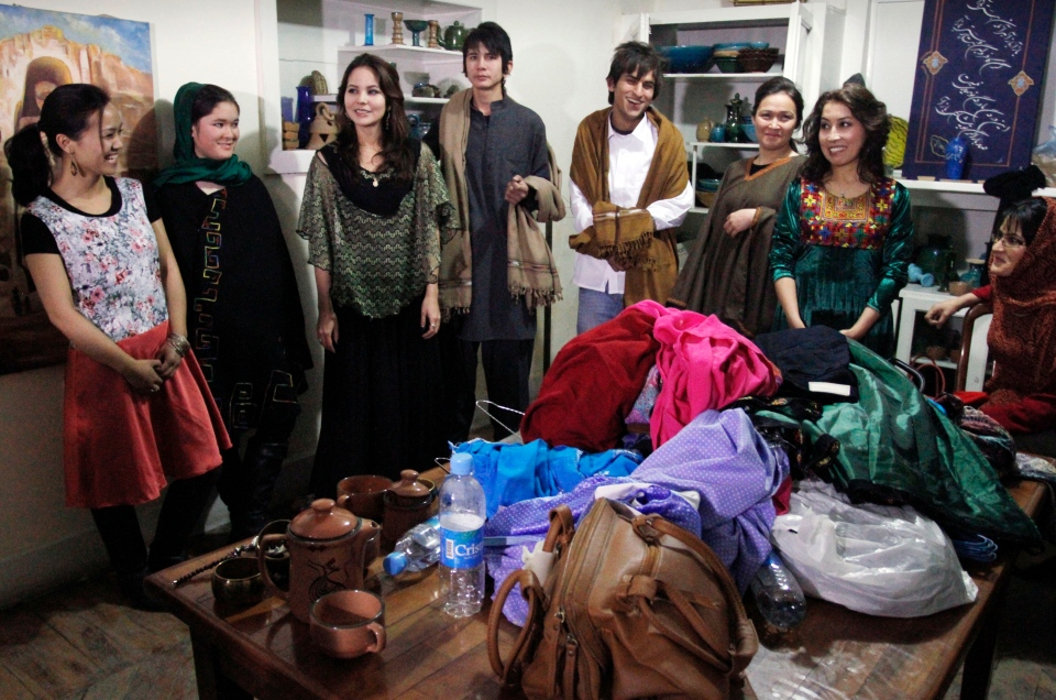 Afghani models are seen backstage after presenting a fashion show in Kabul, Afghanistan, Friday, Feb. 8, 2013. (AP Photo/Musadeq Sadeq)