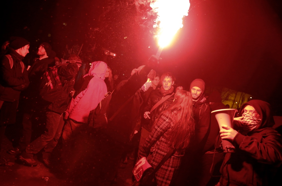 Protesters fire flares during an anti government protest in Ljubljana, Slovenia, Friday, Feb. 8, 2013. (AP Photo/Darko Bandic)