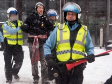 A man is arrested by police during a protest again
