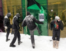 Demonstrators try to break a window at the convent