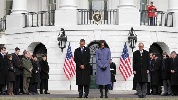 President Barack Obama and first lady Michelle Obama are joined by government employees on the South Lawn of the White House in Washington, Monday, Jan. 10, 2011, to observe a moment of silence for Rep. Gabrielle Giffords, D-Ariz., and the other victims of an assassination attempt against her. (AP Photo / J. Scott Applewhite)
