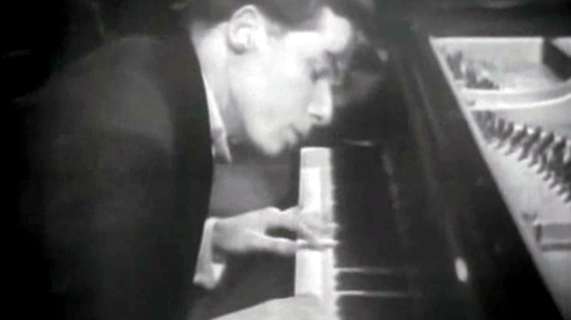 Canadian pianist Glenn Gould rehearses at his piano in this photo taken from video.