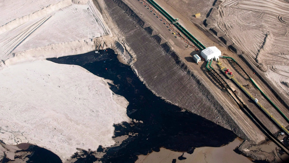An oilsands facility is seen from a helicopter near Fort McMurray, Alta., in July 2012. (Jeff McIntosh / THE CANADIAN PRESS)
