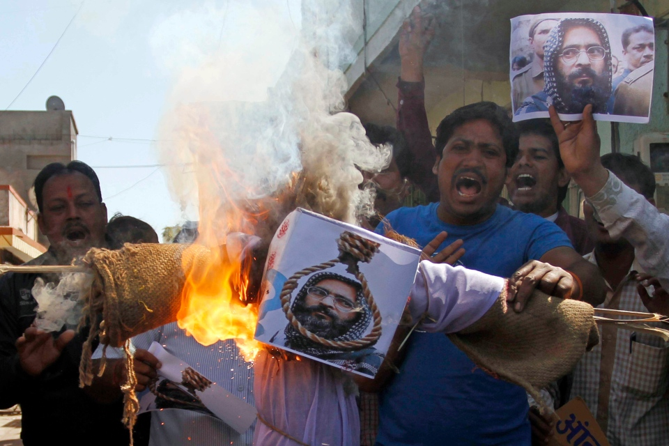 Indians burn an effigy of Kashmiri Mohammed Afzal Guru as they celebrate his execution in Ahmadabad, India on Saturday, Feb. 9, 2013. (AP / Ajit Solanki)