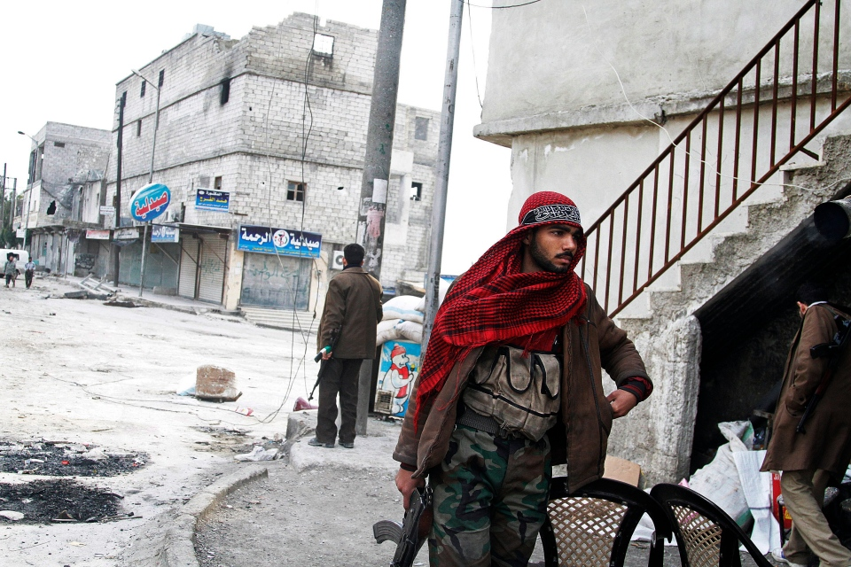 In this Friday February 8, 2013, photo, a Free Syrian Army fighters patrols close to the front lines near a main highway in Aleppo, Syria. (AP / Abdullah al-Yassin)