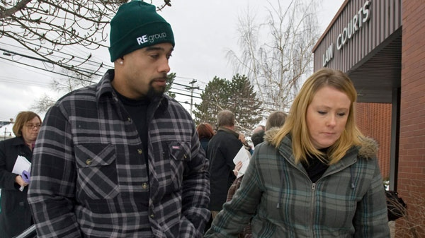 Shayne Howe and his wife Michelle Lyon head from the sentencing of Nathan Rehberg at provincial court in Kentville, N.S. on Monday, Jan. 10, 2011. (Andrew Vaughan / THE CANADIAN PRESS)