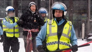 A man is arrested by police during a protest against Quebec's developmental Plan North in Montreal on Friday, February 8, 2013. (Ryan Remiorz / THE CANADIAN PRESS)
