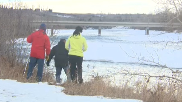 Volunteers search for signs of Sandra Mykytiuk-Evans along the Bow River on February 9, 2013