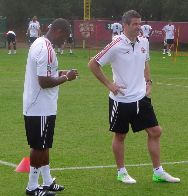 Toronto FC coach Ryan Nelsen (R) at training camp
