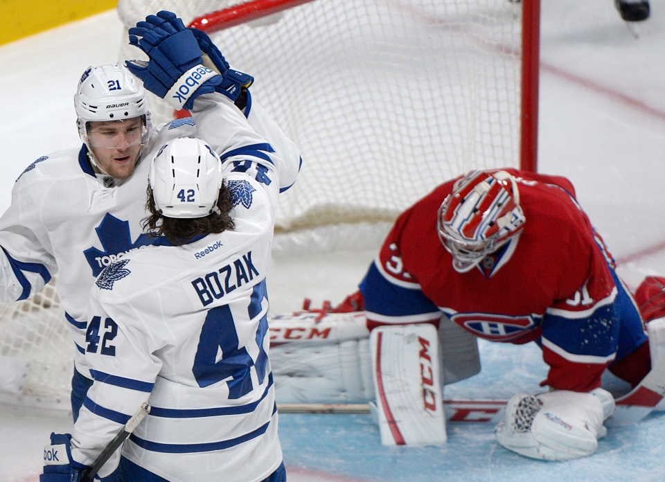 Toronto Maple Leafs' James van Riemsdyk, left, celebrates with teammate Tyler Bozak after scoring against Montreal Canadiens goaltender Carey Price during second period NHL hockey action in Montreal, Saturday, February 9, 2013. (Graham Hughes/ THE CANADIAN PRESS)