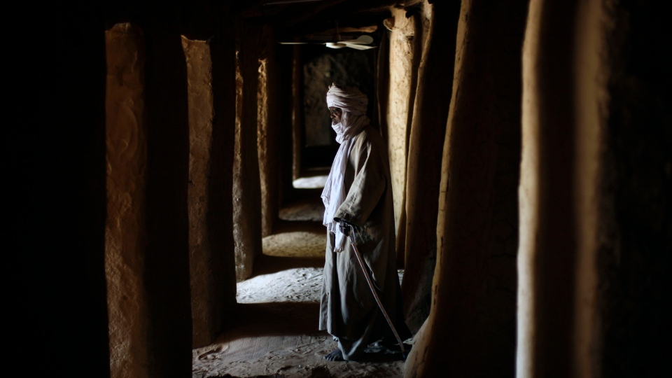 Worshipers arrive for prayers at the Askia mausoleum's mosque, built in 1495 in Gao, northern Mali, Saturday Feb. 9, 2013. (AP Photo / Jerome Delay)