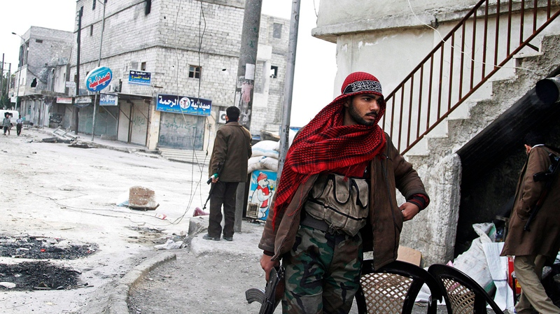 Free Syrian Army fighters patrols close to the front lines near a main highway in Aleppo, Syria, Friday, Feb. 8, 2013. (AP / Abdullah al-Yassin)