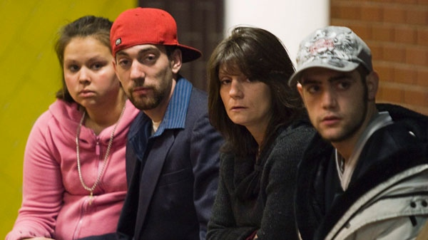 Nathan Rehberg, left, and his brother Justin Rehberg of Avondale, N.S., sit with family and friends at provincial court in Kentville, N.S. on Monday, Jan. 10, 2011. (Andrew Vaughan / THE CANADIAN PRESS)