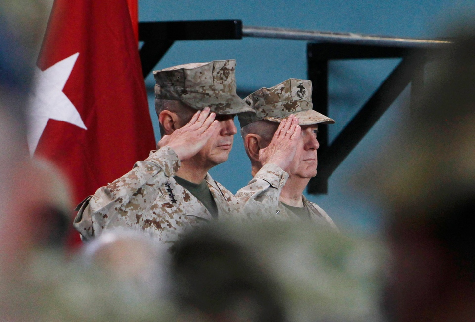 U.S. Gen. John Allen, left, salutes with upcoming commander in Afghanistan U.S. Gen. Joseph Dunford during a changing of command ceremony in Kabul on Feb. 10, 2013. (AP / Omar Sobhani)