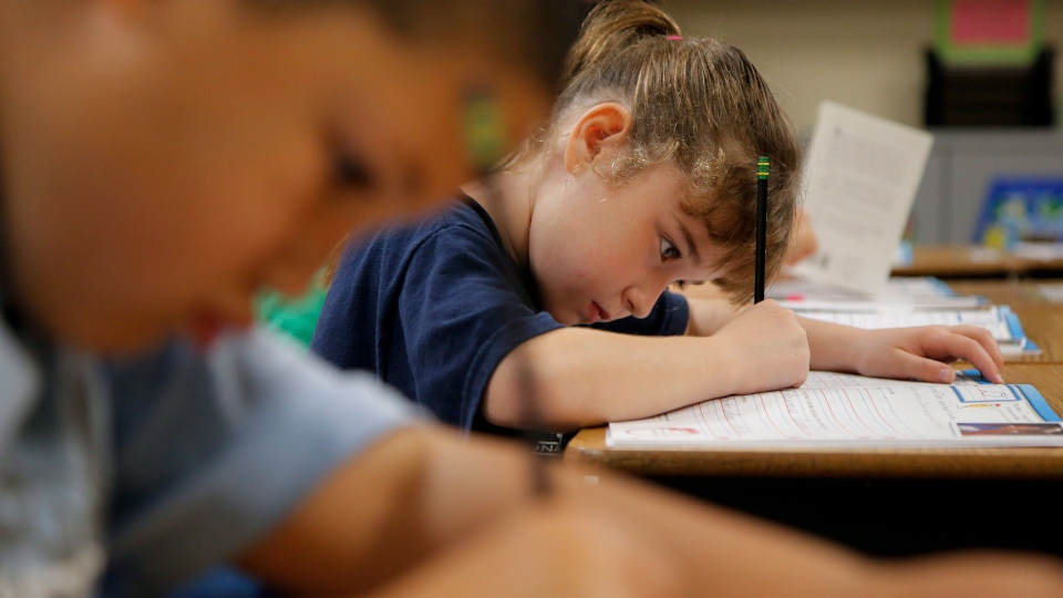 Zoe White practices writing in cursive at St. Mark's Lutheran School in Hacienda Heights, Calif., Thursday, Oct. 18, 2012. (AP / Jae C. Hong)