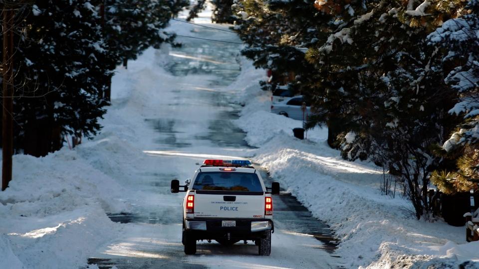 A police vehicle patrols the streets of Big Bear Lake, Calif., Saturday, Feb. 9, 2013. (AP / Jae C. Hong)