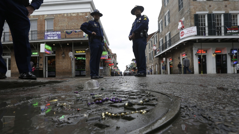 Louisiana State Police stand near the 400 block of Bourbon Street in the French Quarter in New Orleans, Sunday, Feb. 10, 2013. (AP / Gerald Herbert)