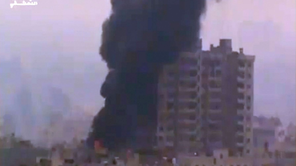 Smoke and fire billow from an explosion in Damascus, Syria, Wednesday, Feb. 6, 2013. (Ugarit News via AP video)