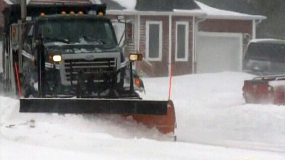 Snowplows work to clear the snow in Newfoundland on Sunday, Feb. 10, 2013.