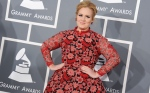 Adele arrives at the 55th annual Grammy Awards in Los Angeles on Sunday, Feb. 10, 2013. (AP / Jordan Strauss)