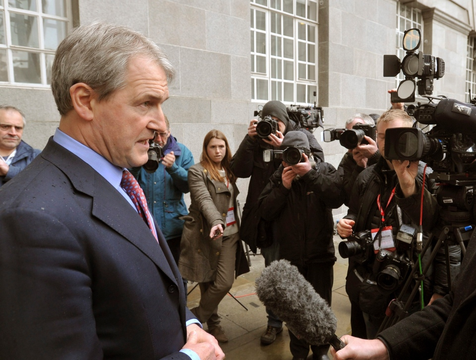 Britain's Secretary of State for Environment, Food and Rural Affairs Owen Paterson, left, speaks to the media outside Defra Headquarters in London after an emergency meeting with the Food Standards Agency (FSA) in this photo taken Feb. 9, 2013. (AP  / John Stillwell)