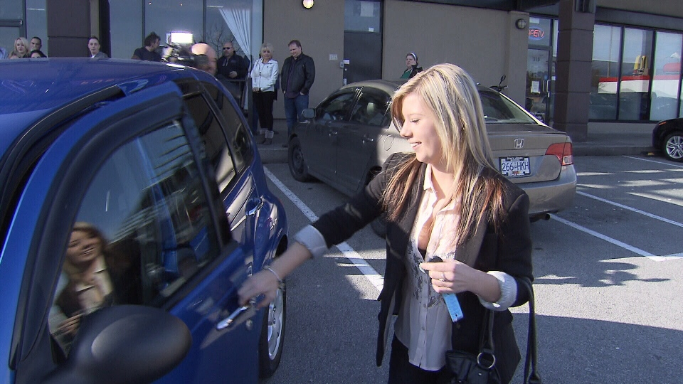 Alex, 17, opens the door to her new PT Cruiser Sunday, Feb. 10, 2013. The Maple Ridge teenager was given the car three weeks after she survived a terrifying ordeal in which she was kidnapped and assaulted in a car she had only just purchased. (CTV)