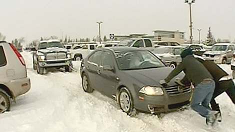 Motorists at a Century Park LRT station in Edmonton struggle to move their vehicles, Monday, Jan. 10, 2011.